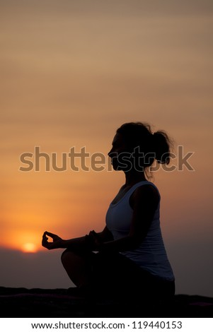 Vertical image of woman practicing yoga - stock photo