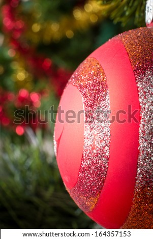 Vertical macro picture of christmas ball on tree. - stock photo