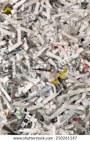 vertical orientation close up of shredded paper as a background, with copy space /  Shredded Background - stock photo