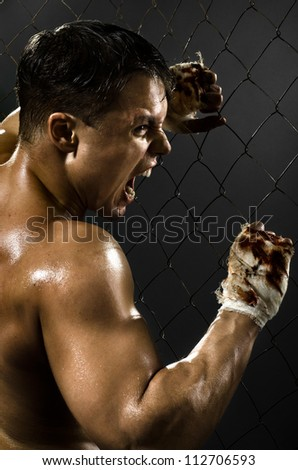 vertical photo  muscular young  guy street-fighter,  aggression awesome yell , hard light - stock photo