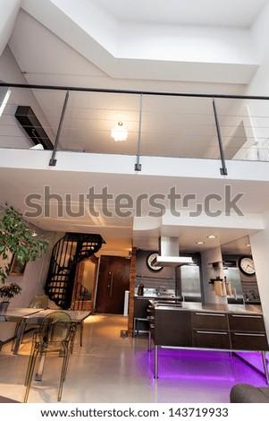 Vertical photo of a loft apartment, modern interior - stock photo