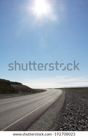 Vertical photo with asphalt road in sunny day - stock photo