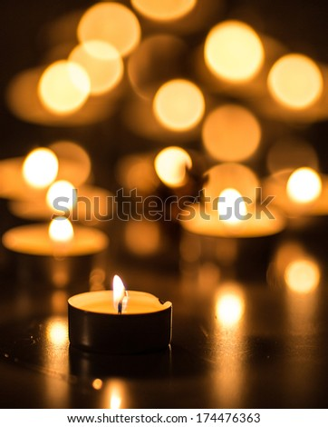 Vertical picture of bokeh tea candles - stock photo