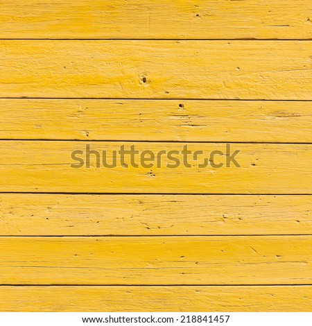 vertical picture of old horizontal planks with bright yellow paint - stock photo