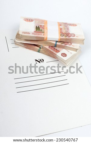 Vertical picture of packs of the ruble notes piled on the white folder - stock photo