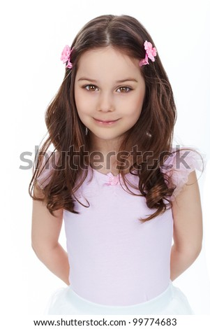 Vertical portrait of a charming girl smiling at camera, isolated on white background - stock photo