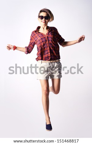 Vertical portrait of a dynamic teen dressed in trendy clothes - stock photo