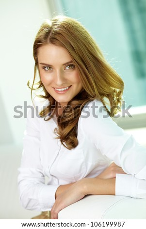 Vertical portrait of a gorgeous girl dressed in smart casual - stock photo