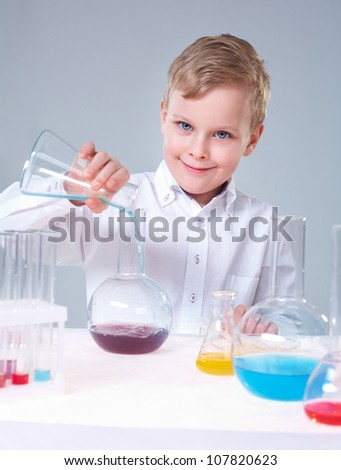 Vertical portrait of a lovely boy making scientific research - stock photo