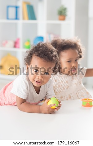 Vertical portrait of a small playing boy on the foreground  - stock photo