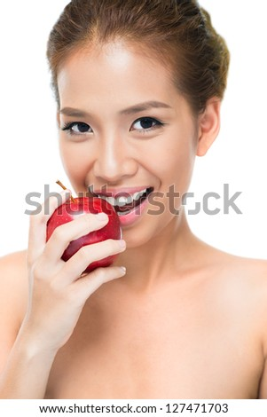 Vertical portrait of a smiling beauty enjoying juicy apple - stock photo