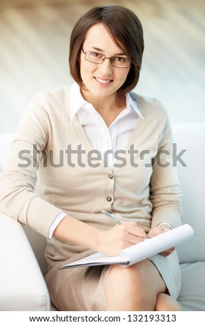 Vertical portrait of a successful psychologist or a businesswoman - stock photo