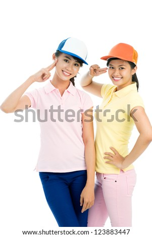 Vertical portrait of enthusiastic scout girls doing hand signs - stock photo