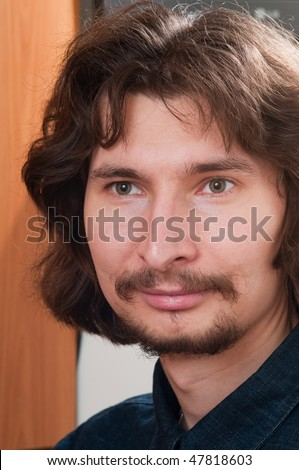 Vertical portrait of the young man with good mood. - stock photo