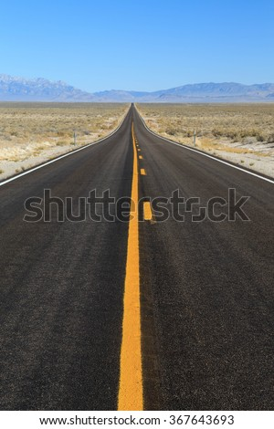Vertical road image in central Nevada, USA. - stock photo