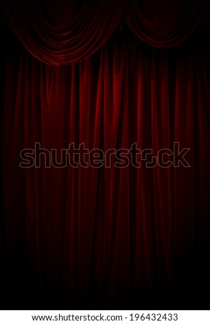 Vertical shot of a dark red curtain. - stock photo