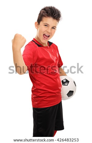 Vertical shot of a joyful junior football player with gripped fist isolated on white background - stock photo