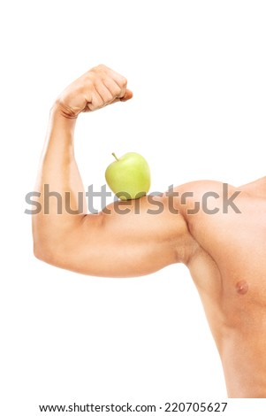 Vertical shot of a muscular arm with an apple on the bicep isolated on white background - stock photo