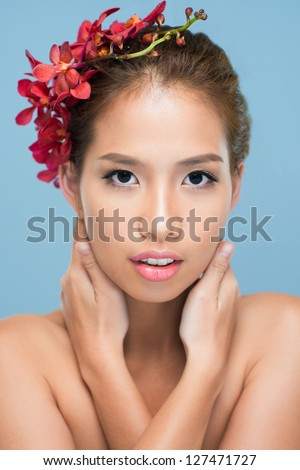 Vertical shot of a posing fashion model with perfect complexion - stock photo