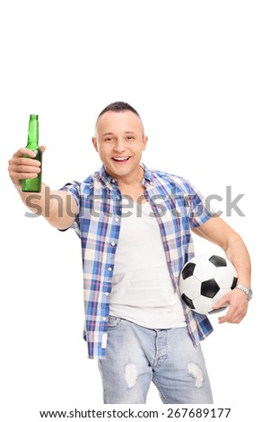Vertical shot of a young football fan holding a beer, cheering and looking at the camera isolated on white background - stock photo