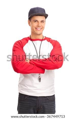 Vertical shot of a young male sports coach with a whistle around his neck isolated on white background - stock photo