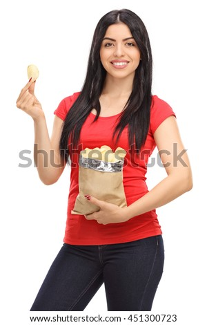 Vertical shot of a young woman eating potato chips from a bag isolated on white background - stock photo