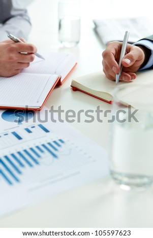 Vertical shot of business people in the midst of the working process - stock photo