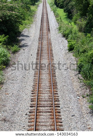Vertical shot of train tracks going off into the distance. - stock photo