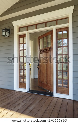 Doormat stock photos images pictures shutterstock for Front door with opening window