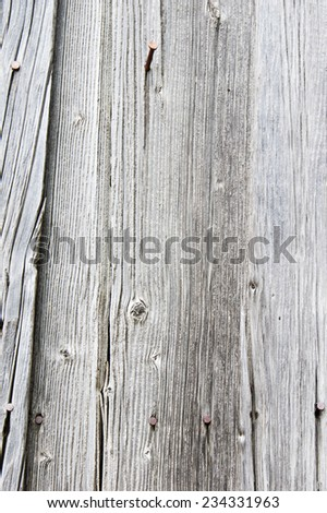 Vertical siding boards with gray finish for use as texture - stock photo