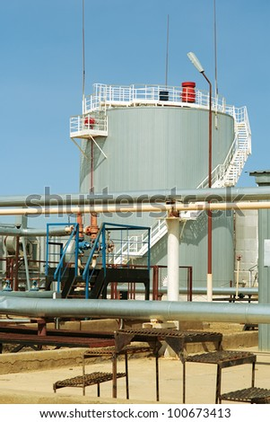 Vertical steel reservoir,for the storage of fire water. - stock photo