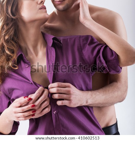 Vertical view of a husband undressing wife - stock photo