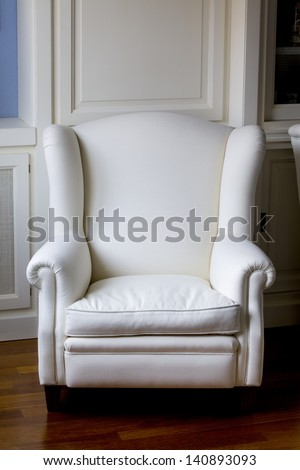 Vertical view of a white classic armchair. White Armchair. - stock photo