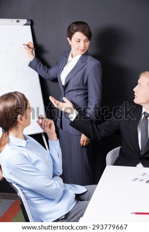 Vertical view of business meeting with presentation - stock photo