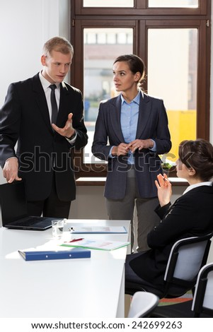 Vertical view of co-workers having business meeting - stock photo