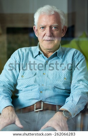 Vertical view of elegant senior man on wheelchair - stock photo
