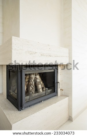 Vertical view of fireplace with wood inside - stock photo