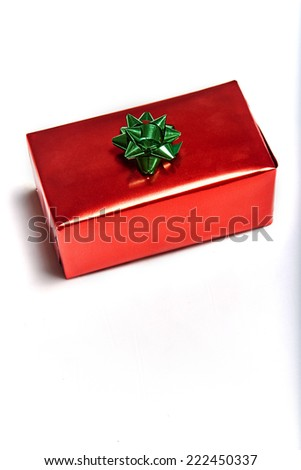 Vertical view of gift box with bow on white background - stock photo