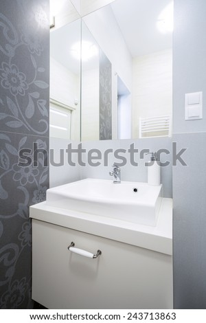 Vertical view of grey and white bathroom - stock photo