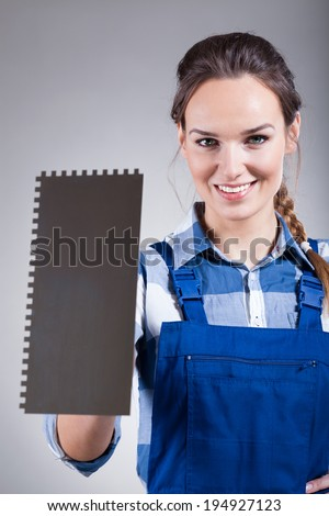 Vertical view of handywoman with a spatula - stock photo