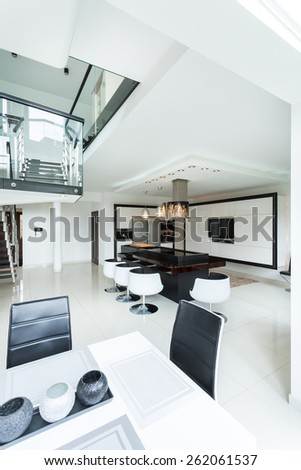 Vertical view of luxury elegant kitchen with marble island - stock photo