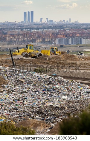 Vertical view of machines working in a dump near Madrid. Dump near Madrid  - stock photo