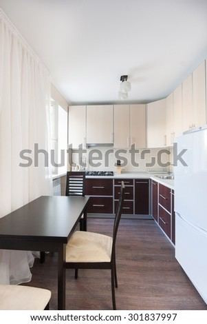 Vertical view of modern furniture in kitchen - stock photo