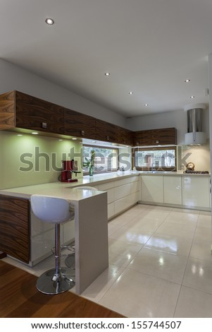 Vertical view of new and modern kitchen interior - stock photo