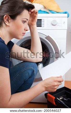 Vertical view of problem with washing machine - stock photo