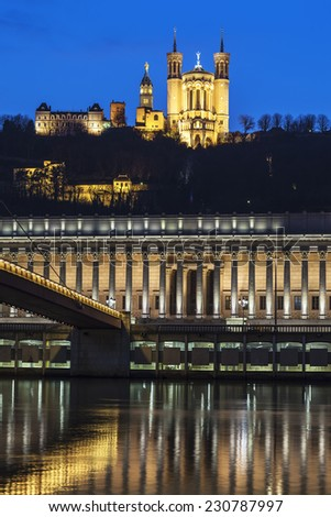 Vertical view of Saone river and basilica at Lyon by night, France - stock photo