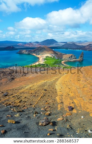 Vertical view of the landscape around Pinnacle Rock in Bartolome Island in the Galapagos Islands - stock photo