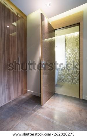 Vertical view of wooden door to living room - stock photo
