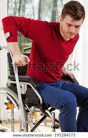 Vertical with a disabled man with crutches - stock photo