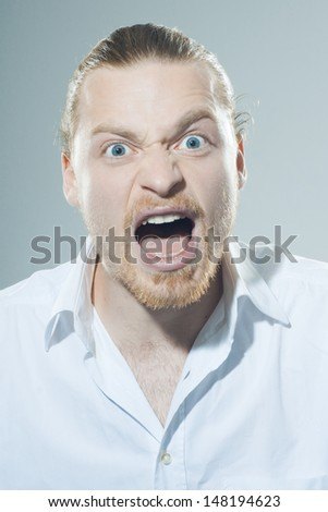 Very angry man screaming - stock photo